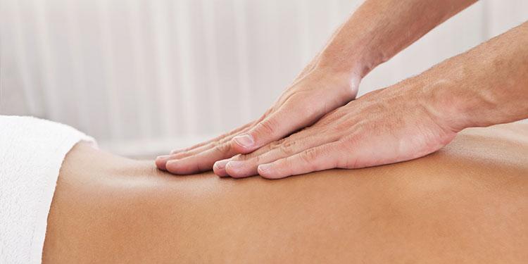 A back being massaged.